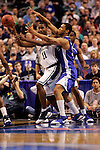 Connecticut center Hilton Armstrong (11) makes a pass in front of Kentucky forward Randolph Morris (33).  Connecticut defeated Kentucky 87-83 in the second round of the NCAA Tournament  at the Wachovia Center in Philadelphia, Pennsylvania on March 19, 2006.
