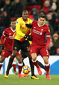 17th March 2018, Anfield, Liverpool, England; EPL Premier League football, Liverpool versus Watford; Roberto Firmino of Liverpool shrugs off the challenge of Abdoulaye Doucoure of Watford to run at goal