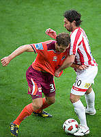 MELBOURNE, AUSTRALIA - NOVEMBER 14: Wayne Srhoj of the Heart and Luke DeVere of the Roar compete for the ball during the round 14 A-League match between the Melbourne Heart and Brisbane Roar at AAMI Park on November 14, 2010 in Melbourne, Australia (Photo by Sydney Low / Asterisk Images)
