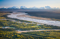 Aerial of the community of Delta Junction, situated on the Big Delta river, Mount Moffit and Mount Hayes, prominent peaks of the Alaska range mountains in the distance.
