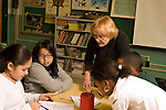 Education Elementary school Grade  4 female science specialist working with small group horizontal