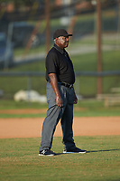 Umpire Chauncey Bowers handles the calls on the bases during the Southern Collegiate Baseball League game between the Concord A's and the Mooresville Spinners at Moor Park on July 31, 2020 in Mooresville, NC. The Spinners defeated the Athletics 6-3 in a game called after 6 innings due to rain. (Brian Westerholt/Four Seam Images)