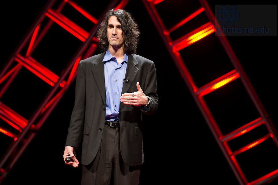 """Jan. 20, 2014; Agustin Fuentes delivers his talk titled, """"It's Not All Sex and Violence:Cooperation in Human Evolution,"""" during the TEDxUND 2014 event in the Debartolo Performing Arts Center. Photo by Barbara Johnston/University Photographer"""