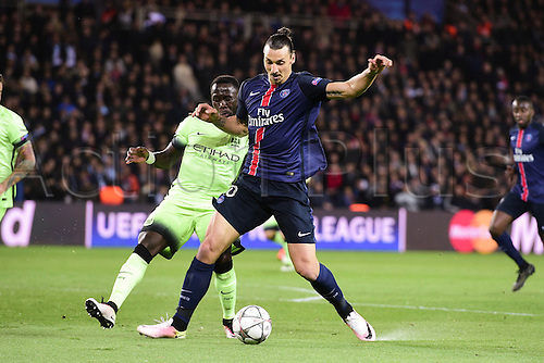 06.04.2016. Paris, France. UEFA CHampions League, quarter-final. Paris St Germain versus Manchester City.  Zlatan Ibrahimovic (PSG) holds off Bacary Sagna (Manchester City)