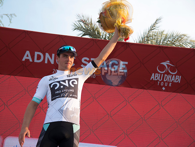 Dion Smith (NZL) One Pro Cycling wears the young rider's White Jersey on the podium at the end of Stage 1 The ADNOC Stage of the 2016 Abu Dhabi Tour running 147km from Madinat Zayed to Madinat Zayed, Abu Dhabi, United Arab Emirates. 20th October 2016.<br /> Picture: ANSA/Luca Zennaro | Newsfile<br /> <br /> <br /> All photos usage must carry mandatory copyright credit (&copy; Newsfile | ANSA/Claudio Peri)