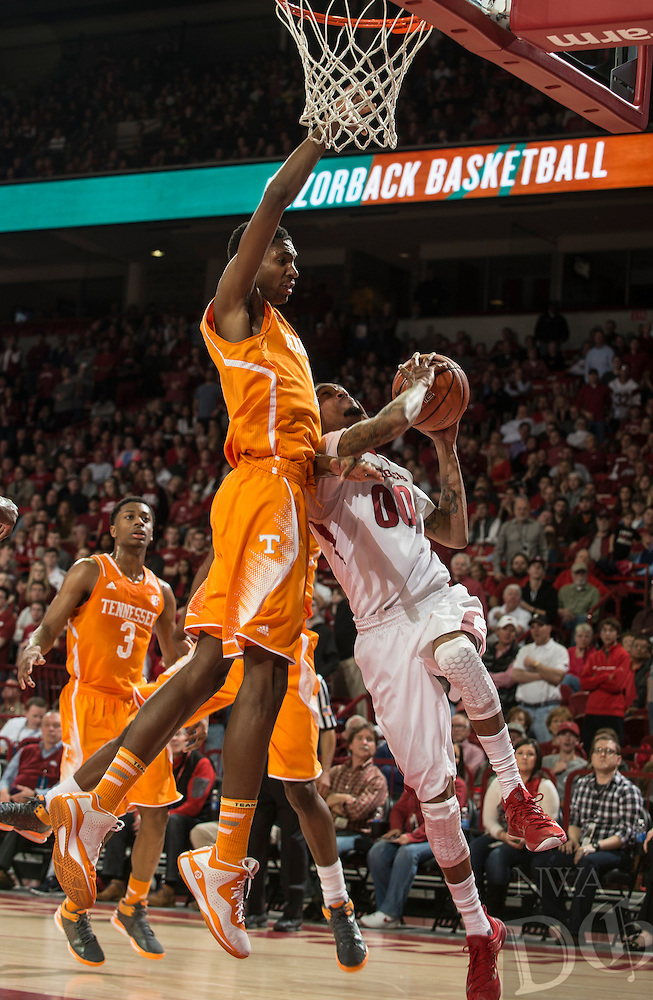 NWA Democrat-Gazette/ANTHONY REYES • @NWATONYR<br /> Rashad Madden, Arkansas senior, makes a shot as Tariq Owens, Tennessee forward, defends in the first half Tuesday, Jan. 27, 2015 in Bud Walton Arena in Fayetteville.