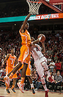 NWA Democrat-Gazette/ANTHONY REYES &bull; @NWATONYR<br /> Rashad Madden, Arkansas senior, makes a shot as Tariq Owens, Tennessee forward, defends in the first half Tuesday, Jan. 27, 2015 in Bud Walton Arena in Fayetteville.