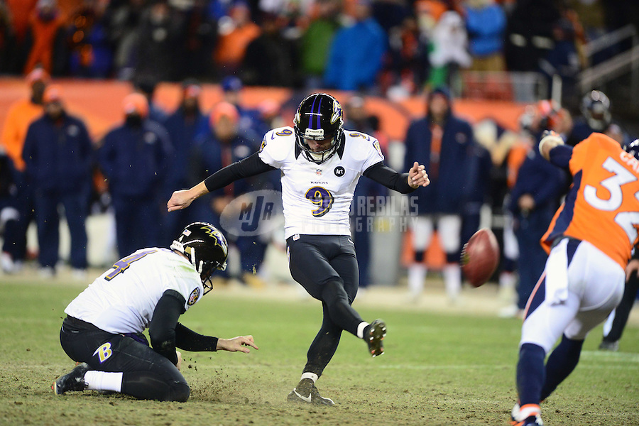 Jan 12, 2013; Denver, CO, USA; Baltimore Ravens kicker Justin Tucker (9) kicks the game winning field goal in double overtime against the Denver Broncos during the AFC divisional round playoff game at Sports Authority Field.  The Ravens defeated the Broncos 38-35 in double overtime. Mandatory Credit: Mark J. Rebilas-