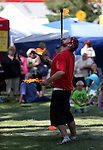 Spike McGuire juggles at the NV150 Fair at Fuji Park, in Carson City, Nev., on Saturday, Aug. 2, 2014.<br /> Photo by Cathleen Allison
