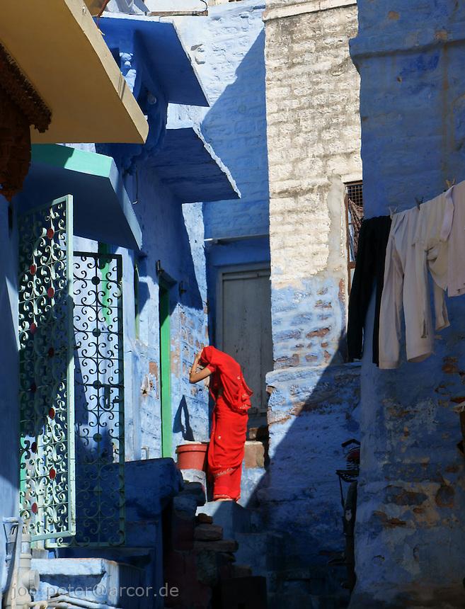woman in red sari in streets of Jodhpur, Rajastan, India