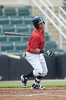 Ramon Beltre (22) of the Kannapolis Intimidators follows through on his swing against the Greensboro Grasshoppers at Kannapolis Intimidators Stadium on August 5, 2018 in Kannapolis, North Carolina. The Grasshoppers defeated the Intimidators 2-1 in game one of a double-header.  (Brian Westerholt/Four Seam Images)