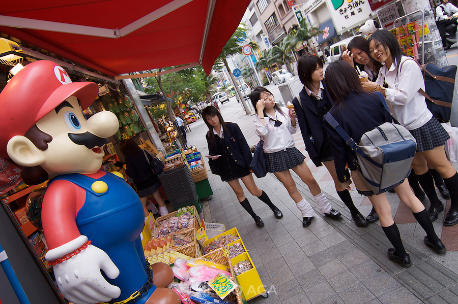 Kokusai-do?ri amusement and shopping street. School girls with Super Mario.