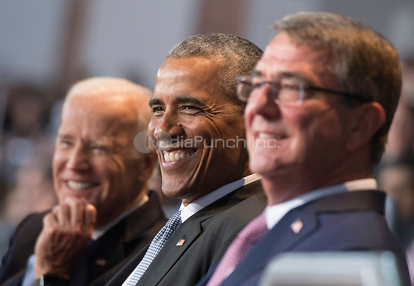 United States President Barack Obama (R), Vice President Joe Biden (C) and Chairman of the Joint Chiefs of Staff Gen. Joseph Dunford Jr. attends the Armed Forces Full Honor Review Farewell Ceremony for President Obama at Joint Base Myers-Henderson Hall, in Virginia on January 4, 2017. The five braces of the military honored the president and vice-president for their service as they conclude their final term in office. <br /> Credit: Kevin Dietsch / Pool via CNP /MediaPunch