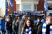 Pictured: A stall selling Everton flags and scarves on Goodison Road outside the stadium. Sunday 16 February 2014<br />