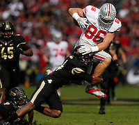 Ohio State Buckeyes tight end Jeff Heuerman (86) is tackled by Purdue Boilermakers safety Taylor Richards (4) during Saturday's NCAA Division I football game at Ross-Ade Stadium in West Lafayette, In. on November 2, 2013. (Barbara J. Perenic/The Columbus Dispatch)