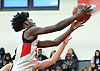Julius Goddard #21 of Amityville grabs a rebound during a Suffolk County varsity boys basketball game against Sayville at Amityville High School on Thursday, Jan. 5, 2017. Amityville won by a score of 81-73.