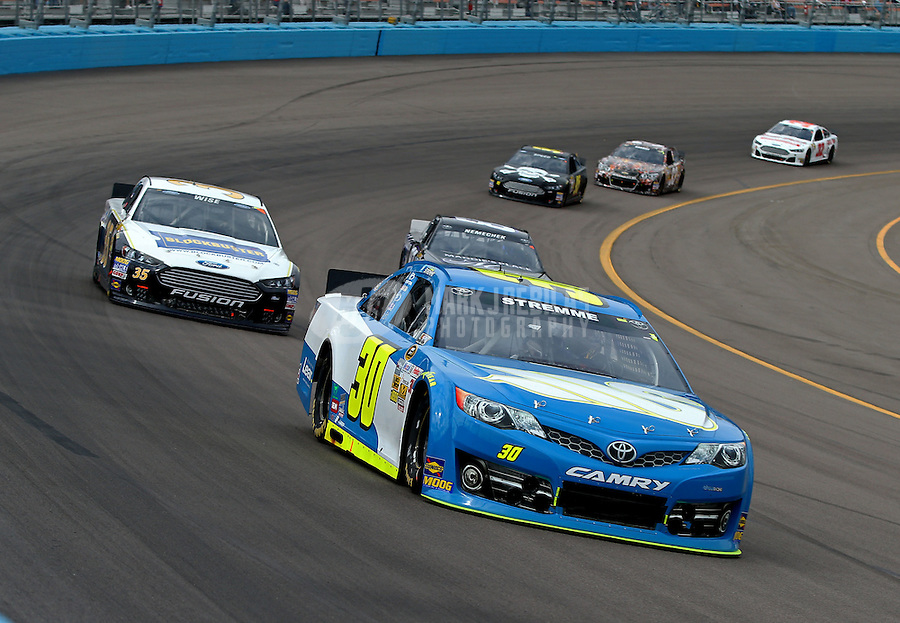 Mar. 3, 2013; Avondale, AZ, USA; NASCAR Sprint Cup Series driver David Stremme leads Josh Wise during the Subway Fresh Fit 500 at Phoenix International Raceway. Mandatory Credit: Mark J. Rebilas-