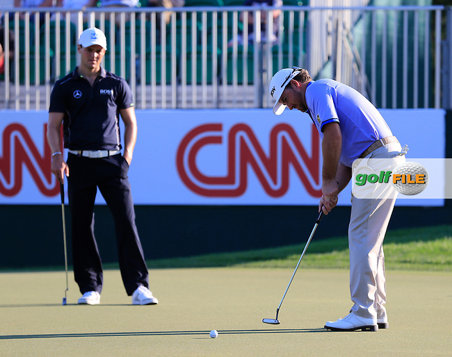 Graeme McDOWELL (NIR) putts during Tuesday's Challenge Match 2 man scramble of the 2015 Omega Dubai Desert Classic held at the Emirates Golf Club, Dubai, UAE.: Picture Eoin Clarke, www.golffile.ie: 1/27/2015