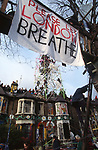A large sheet with &quot;Please let London Breathe&quot; hangs from a treehouse as road protestors occupy the scaffolding tower and buildings as the eviction begins. Claremont Road, Leytonstone, London. Claremont Road, ran immediately next to the Central line, and was completely occupied by protesters. The road became a vibrant squatter community full of site specific art installations. 92-year-old Dolly Watson was an original resident refused the D.O.T's offer to move. She became friends with the road protesters, who named the watchtower, built from scaffold poles, after her.<br />