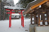 Jigokudani, Nagano Prefecture, Japan<br /> Shinto shrine with red torii gate in winter storm