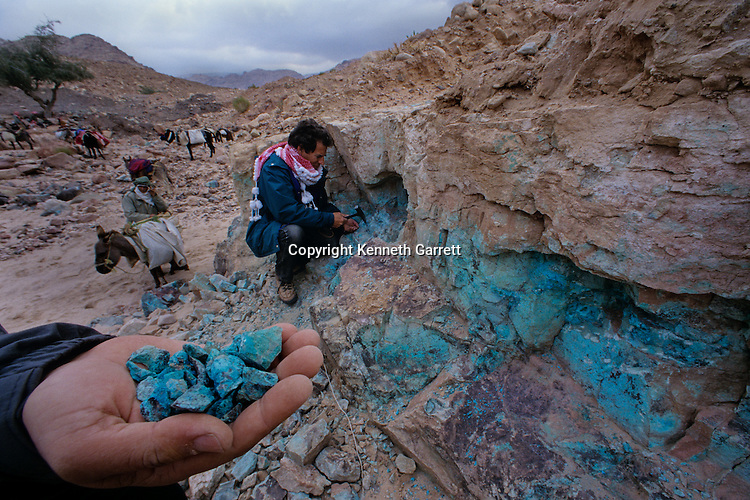 Archaeologist Thomas Levy picks at copper ore, Wadi Faynan, western Jordan, mined from Copper Age site