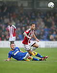 AFC Wimbledon's George Francomb tussles with Sheffield United's Billy Sharp during the League One match at the Kingsmeadow Stadium, London. Picture date: September 10th, 2016. Pic David Klein/Sportimage