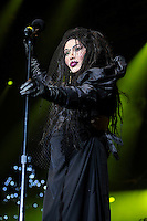 Pete Burns of Dead or Alive<br /> Performing at the PWL Hit Factory Live, o2 Arena, London, England, UK, <br /> 21st December 2012.<br /> music live on stage concert gig half length netting veil black dress gloves shoulder pads microphone <br /> CAP/MAR<br /> &copy; Martin Harris/Capital Pictures /MediaPunch ***NORTH AND SOUTH AMERICAS ONLY*** /MediaPunch ***NORTH AND SOUTH AMERICAS ONLY***