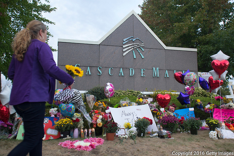 BURLINGTON, WA - SEPTEMBER 26: A memorial is filled with flowers, signs and candles at the Cascade Mall on September 26, 2016 in Burlington, Washington. Five people were killed by a gunman several days ago. The suspect, Arcan Cetin, 20, a resident of Oak Harbor, Washington, made a court appearance today. (Photo by Karen Ducey/Getty Images)