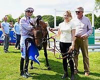Jockey Mitch Godwin (l), Edged Out,stable lass and trainer Christopher Mason in the winners enclosure after winning The Think Cars Ssangyong Paddock Area Display Handicap, during Father's Day Racing at Salisbury Racecourse on 18th June 2017