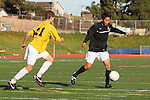 Torrance, CA 01/24/12 - Charles Chae (Peninsula #9) and unidentified West Torrance player(s) in action during the Peninsula vs West Torrance CIF Bay league game.