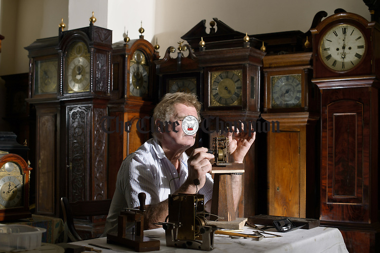 Horologist Nigel Barnes, busy in his workshop, surrounded by antique clocks, at  Clooneenagh in West Clare. Clocks will be put back one hour on this Sunday, October 30th, thus bringing an end to Daylight Savings Time. Photograph by John Kelly.
