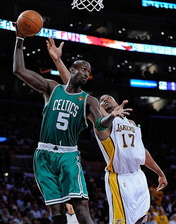 Boston Celtics forward Kevin Garnett, left, takes control of a rebound in front of Los Angeles Lakers center Andrew Bynum during the third quarter of game two of the NBA Finals at the Staples Center on Sunday, June 06, 2010.