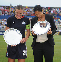 Freedom forward Abby  Wambach receiving the induction of Hall of Freedom on behalf of David Valone former Assistant coach from the Freedom and  Steffi Jones (former Freedom player)   The LA Sol defeated the Washington Freedom 1-0 at the Maryland Soccerplex, Sunday July 5, 2009.