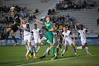 Santa Barbara, CA - Friday, December 7, 2018:  Akron men's soccer defeated Michigan State 5-1 in a semi-final match in the 2018 College Cup.  Akron goalkeeper Ben Lundt and teammates defend a Michigan State header