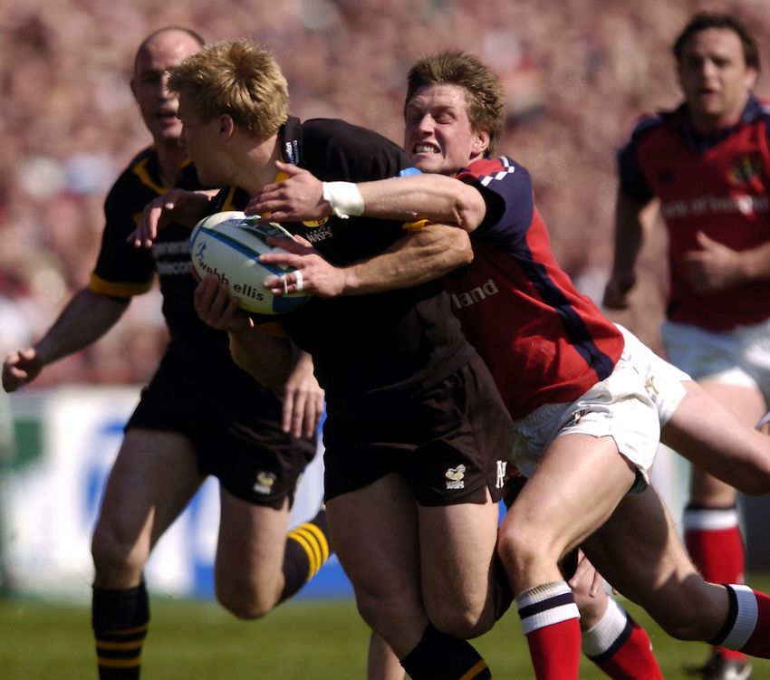 Photo. Richard Lane. .Munster v London Wasps. Heineken Cup Semi Final. 25/04/2004..Ronan O'Gara tackled Stuart Abbott..