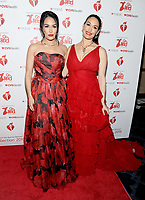 NEW YORK, NY - FEBRUARY 07: Brie Bella and Nicki Bella  attends The American Heart Association's Go Red For Women Red Dress Collection 2019 Presented By Macy's at Hammerstein Ballroom on February 7, 2019 in New York City.     <br /> CAP/MPI/GN<br /> ©GN/MPI/Capital Pictures
