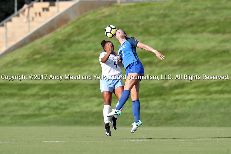 CARY, NC - AUGUST 18: Duke's Ella Stevens (17) and North Carolina's Maya Worth (5). The University of North Carolina Tar Heels hosted the Duke University Blue Devils on August 18, 2017, at Koka Booth Stadium in Cary, NC in a Division I college soccer game.