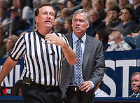 California's Head Coach Mike Montgomery argues with referee during a game against USC at Haas Pavilion in Berkeley, California on February 23th, 2014. California defeated USC 77 - 64