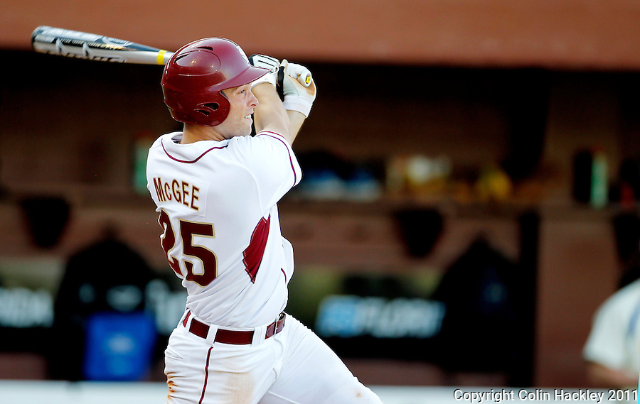 TALLAHASSEE, FL 2/26/11-FSU-HOFSTRA BASE11 CH-Florida State's Mike McGee watches his grand slam homer sail away during fourth inning action against Hofstra Saturday at Dick Howser Stadium in Tallahassee. The Seminoles beat the Pride 16-3...COLIN HACKLEY PHOTO