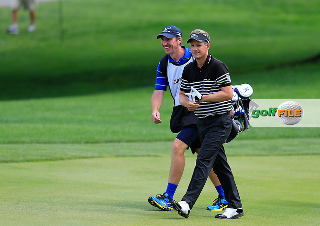 Luke Donald (ENG) and caddy John McLaren walk to the 9th green during Thursday's Round 1 of the 2013 Bridgestone Invitational WGC tournament held at the Firestone Country Club, Akron, Ohio. 1st August 2013.<br /> Picture: Eoin Clarke www.golffile.ie