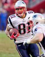 19 April 2017 - Former NFL star Aaron Hernandez, who was serving a life sentence for a murder conviction and just days ago was acquitted of double murder, died after hanging himself in his prison cell early Wednesday, Massachusetts prisons officials said. Guards found Hernandez unresponsive in his cell at the Souza-Baranowski Correctional Center in Shirley. The former New England Patriots tight end was pronounced dead at UMass Memorial-Health Alliance Hospital in Leominster about an hour later. He was 27. File Photo: New England Patriots tight end Aaron Hernandez (81) carries the ball after a reception in the fourth quarter against the Washington Redskins at FedEx Field in Landover, Maryland on Sunday December 11, 2011.  The Patriots won the game 34 - 27. Photo Credit: Ron Sachs/CNP/AdMedia