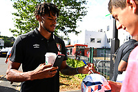 Tyrone Mings of AFC Bournemouth signs a football for a fan during AFC Bournemouth vs Real Betis, Friendly Match Football at the Vitality Stadium on 3rd August 2018