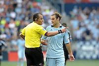 Referee Baldomero Toldeo explains a call to Kansas City midfielder Graham Zusi... Sporting Kansas City defeated San Jose Earthquakes 2-1 at LIVESTRONG Sporting Park, Kansas City, Kansas.