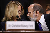 WASHINGTON, DC - SEPTEMBER 27:  Christine Blasey Ford (L) talks with her attorney Michael Bromwich as she prepares to testify before the Senate Judiciary Committee in the Dirksen Senate Office Building on Capitol Hill September 27, 2018 in Washington, DC. A professor at Palo Alto University and a research psychologist at the Stanford University School of Medicine, Ford has accused Supreme Court nominee Judge Brett Kavanaugh of sexually assaulting her during a party in 1982 when they were high school students in suburban Maryland.  (Photo by Win McNamee/Getty Images)