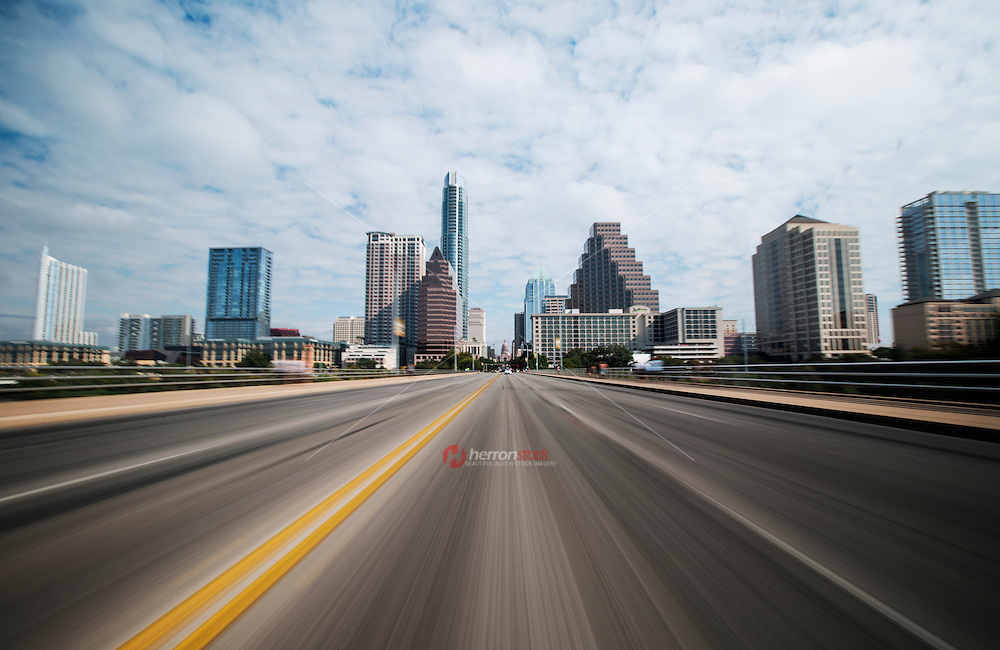 Unique motion blur image of downtown Austin skyline and texas state capitol from Congress Ave., in Austin, Texas.