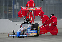 Nov. 12, 2011; Pomona, CA, USA; NHRA top fuel dragster driver T.J. Zizzo during qualifying at the Auto Club Finals at Auto Club Raceway at Pomona. Mandatory Credit: Mark J. Rebilas-.