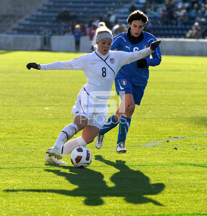 US forward Amy Rodriguez (8) makes a move in front of Italian defender Laura Neboli (6).  The U.S. Women's National Team defeated Italy 1-0 at Toyota Park in Bridgeview, IL on November 27, 2010 to advance to the Women's World Cup in Germany.