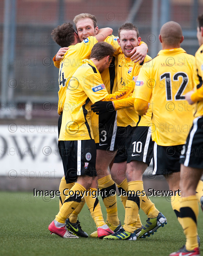 Montrose's Paul Watson (3) celebrates with team mates after he scores their second goal.
