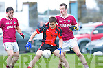 Glenbeigh/Glencar Gavin O'Grady holds off the Dromid full back during their semi final clash in Killorglin on Saturday
