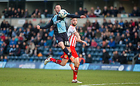 Michael Harriman of Wycombe Wanderers controls the ball under pressure from Fraser Franks of Stevenage during the Sky Bet League 2 match between Wycombe Wanderers and Stevenage at Adams Park, High Wycombe, England on 12 March 2016. Photo by Andy Rowland/PRiME Media Images.